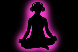 Silhouette of a person meditating while listening to music