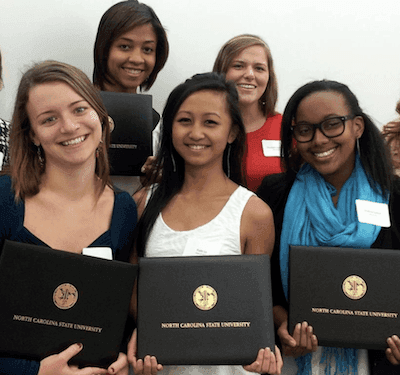 group picture of students posing with certificate