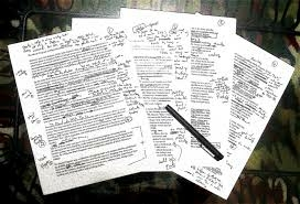 Three sheets of paper with scripts