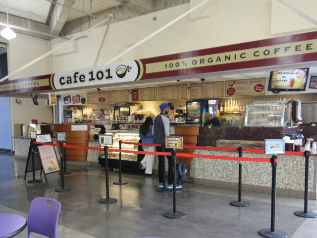 PIcture of cafe 101 with customers lined up
