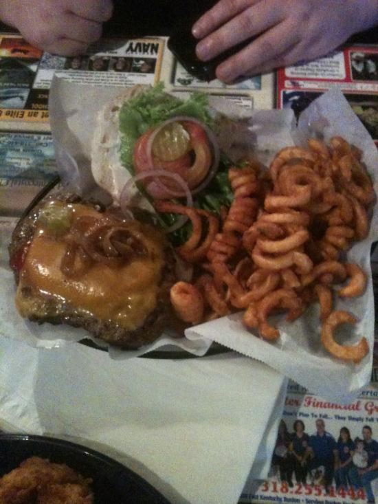 a burger with curly fries