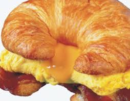 a breakfast sandwich with eggs and cheese