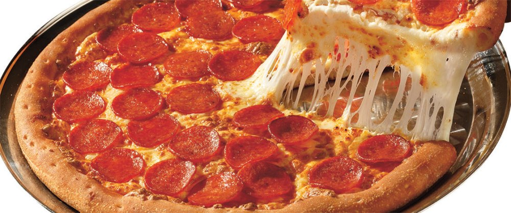 picture of slice of pizza being pulled from the pan