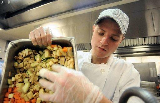 Here, an upperclassman serves as the Cook's Helper.