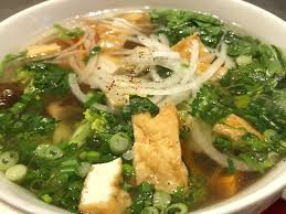 Pho is a Vietnamese soup with rice noodles, broth, and vegetables.