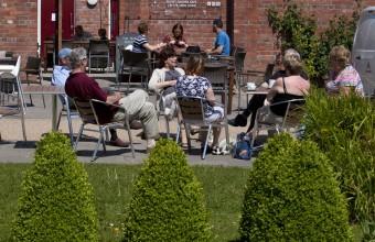 people porchside at secret garden