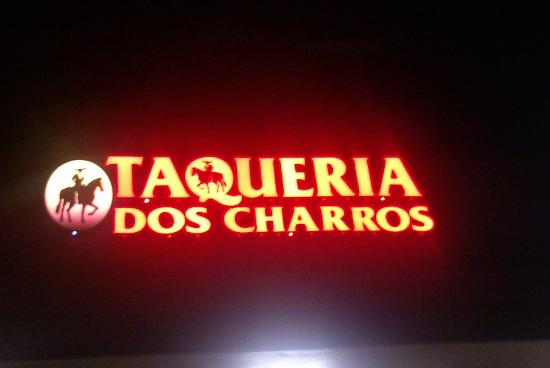 Lit up sign for Taqueria Dos Charros