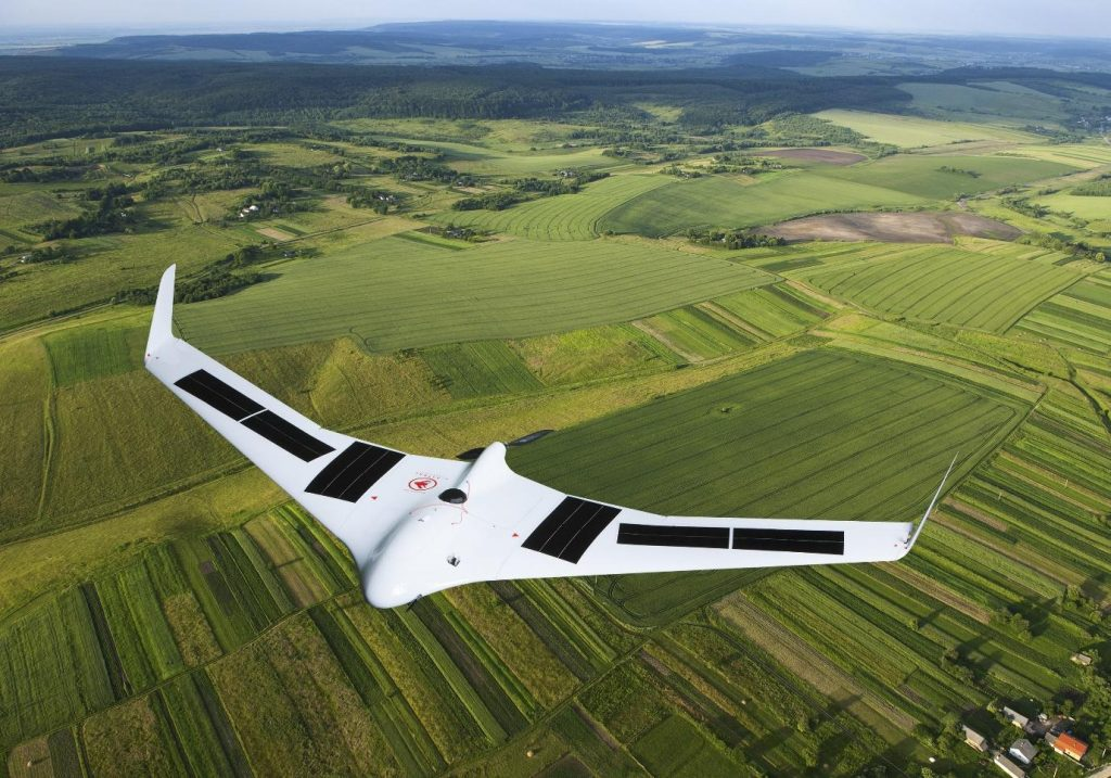 Unmanned Aerial Vehicle flying over fields