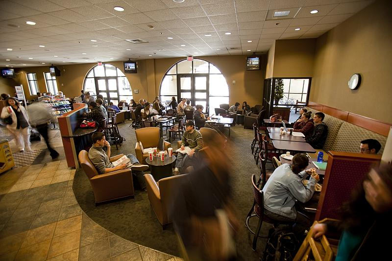 Students sitting of comfortable couches of the dining place