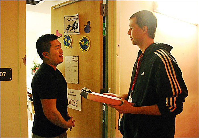 a resident assistant helping a student