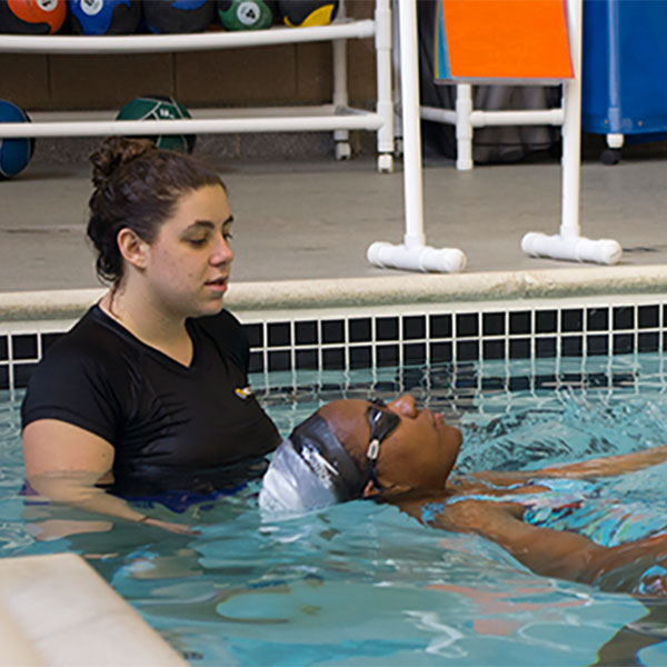 a teacher in the pool with student
