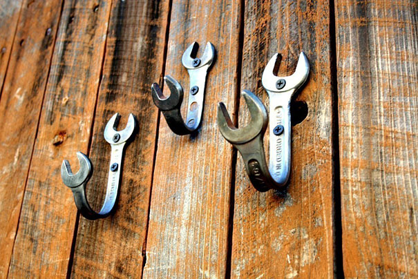 diy image of wrenches repurposed to become hangers by being bent and screwed to wall.