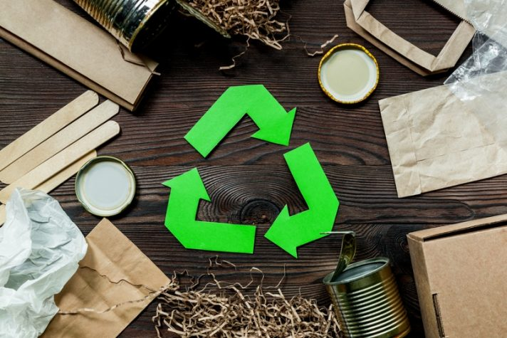 image of recycling logo with recyclables around it. showing what can be recycled