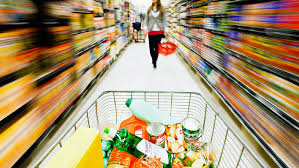a girl shopping grocery items in her shopping cart
