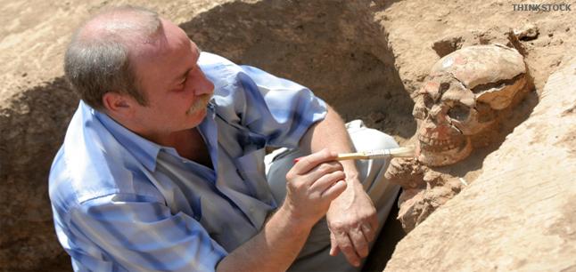 An archaelogist at a site