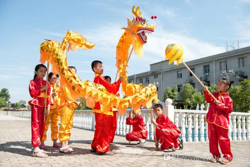 6 kids performing dragon dance