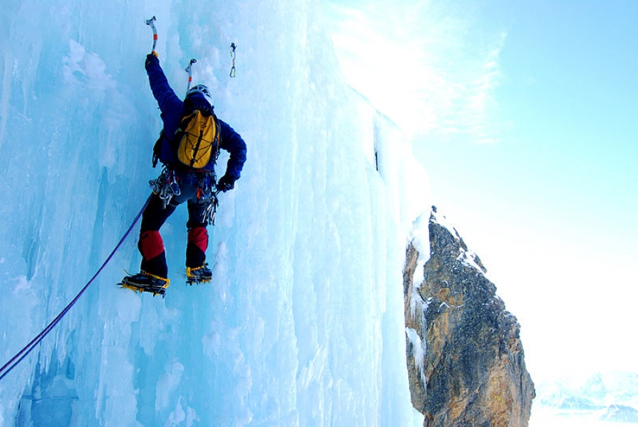 A man climbing Ice in Iceland