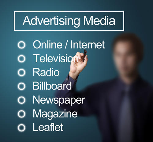 A man listing available advertising media