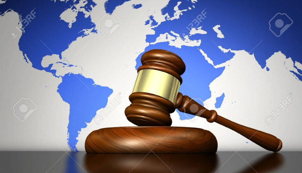Picture of a gavel in front of a world map