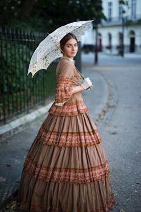 A typical dress for a woman in that era.