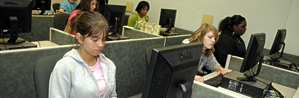 Information technology students on class programming.