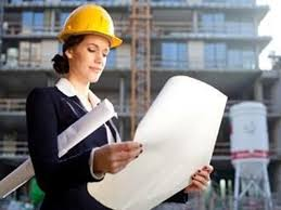An engineer looking at blueprints in a construction site