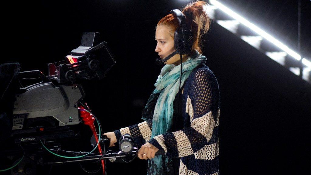 A girl recording the scene in film camera