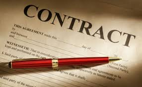 A red pen placed on contract paper
