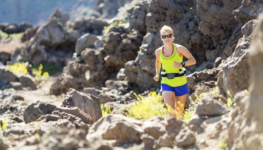 A girl running in rocky land