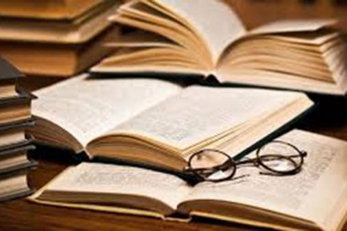 Literature books with eyeglasses on it