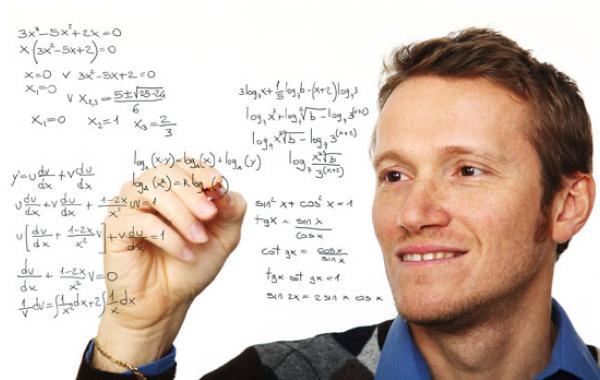 Picture of equations being written on screen by person