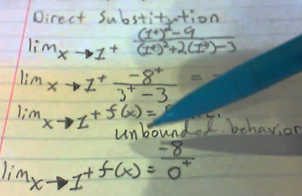 picture of person writing on lined paper solving equations