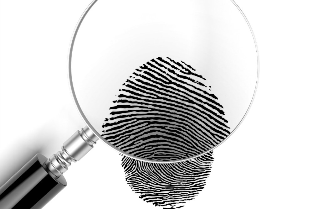 picture of a magnifying glass over a fingerprint