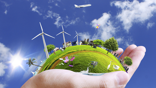 A picture a green world with windpropellors in someone's hand