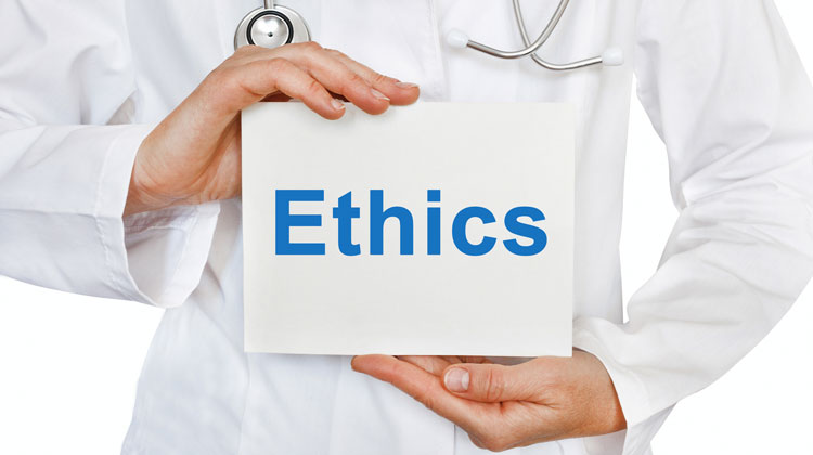 picture of doctor holding sign with ethics on it