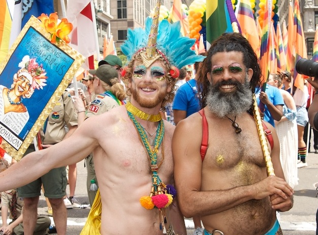 Oicture of two men at a LGBTQ street festival