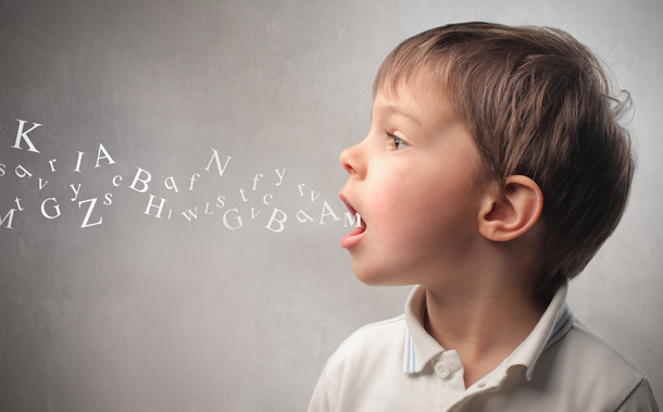 a child communicating in letters out of mouth