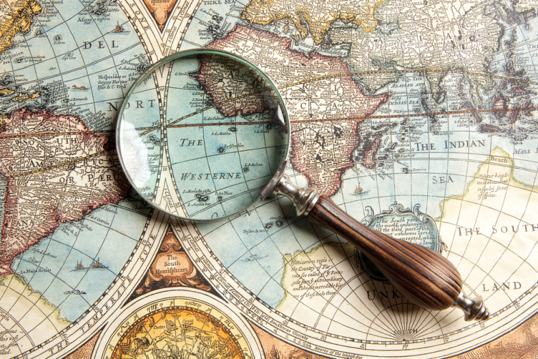 picture of map of the world with a magnifying glass on it