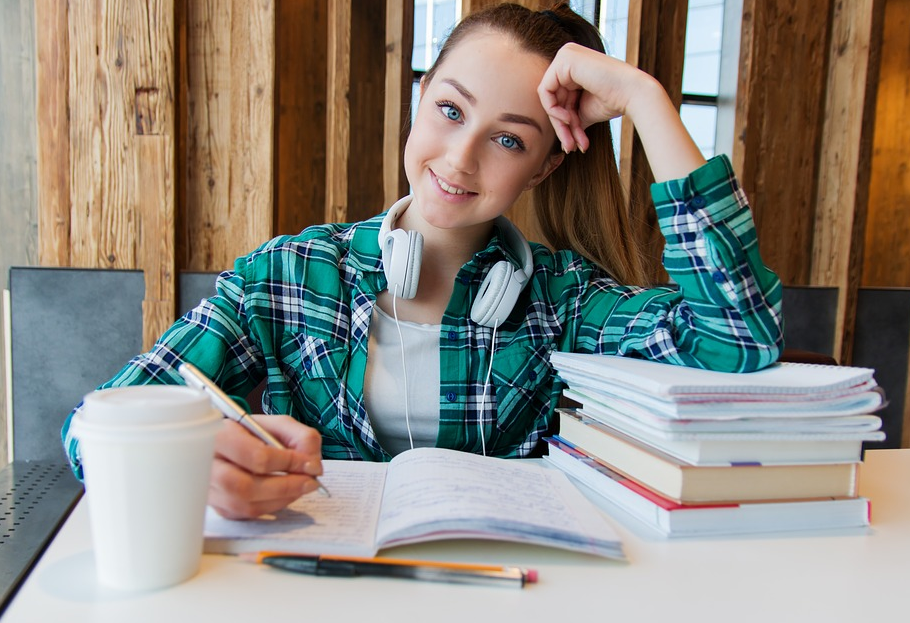 female student with headphones studying