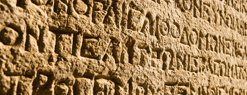 picture of ancient greek language etched on stone