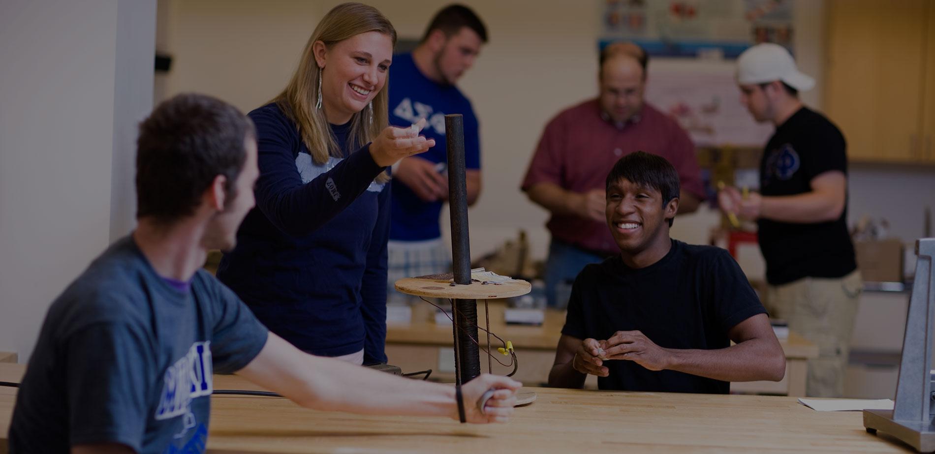 Millikin University students at a physics laboratory.