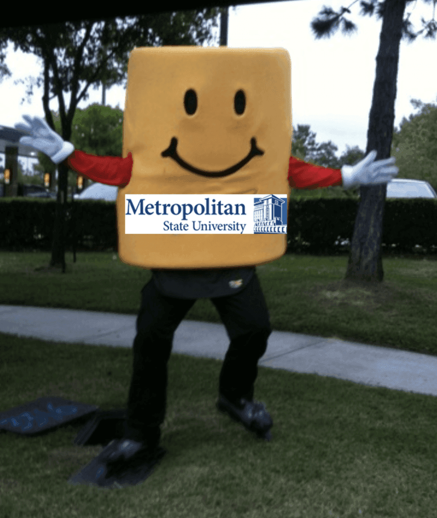 Image of character promoting MSU at an event.