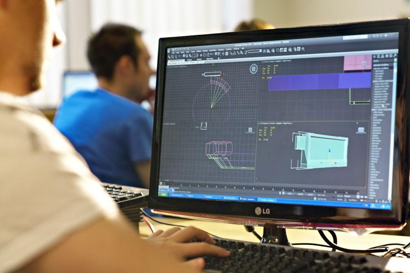 A game developer using a computer