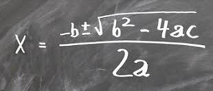 picture of the quadratic equation written in chalk on a black board