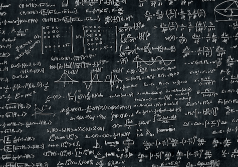 picture of phsyics equations and graphs on blackboard