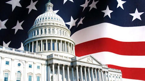 picture of Capitol Hill in front of US flag