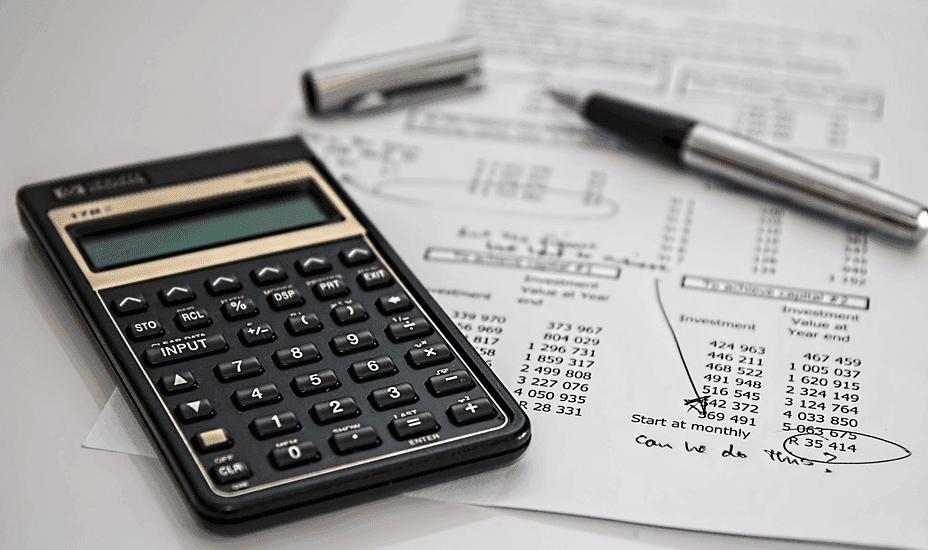 calculator, pen and an exam questionaire