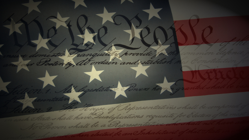 picture of an american flag overlaying the charter of rights