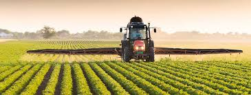 Picture of tractor on field doing agriculture