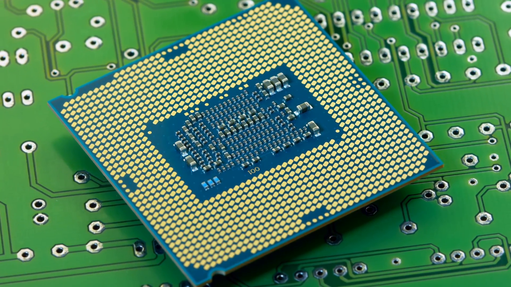 Close-up shot of a rotating microprocessor on a green printed circuit board.
